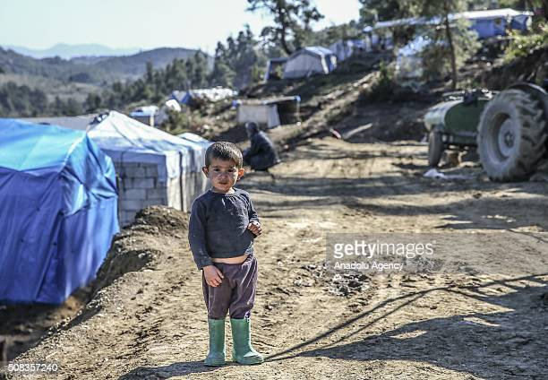 Turkmen kid gestures at Yamadi camp in Lattakia Syria on February 4 2016 Turkmen families fled from their homes due to Russian and Assad Regime...