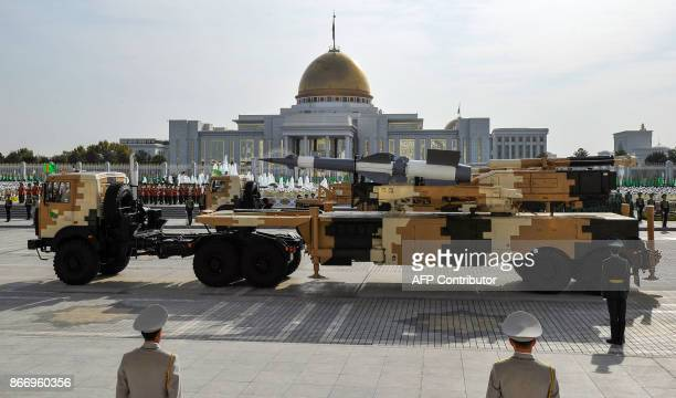 Turkmen military vehicles drive during a military parade in Ashgabat on October 27 on the 26th anniversary of Turkmenistan's independence / AFP PHOTO...