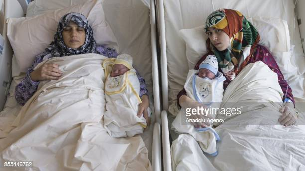 Turkmen mother Fatma Birinci and her daughter Gade Birinci pregnant at the same time lay hospital beds with the babies named Recep and Tayyip after...
