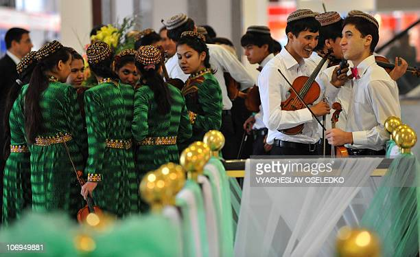 Turkmen musicians wearing traditional embroidered caps speak on November 17 2010 during the opening of the annual oil and gas conference bringing...