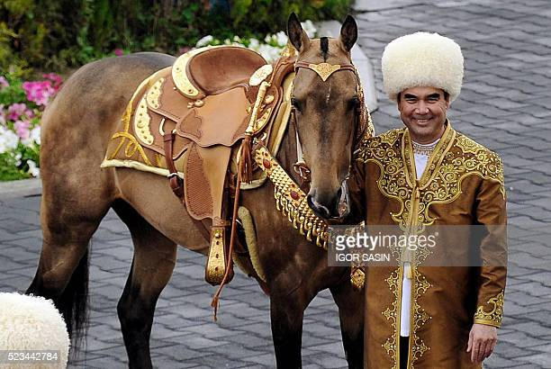 Turkmen President Gurbanguly Berdimuhamedov poses with an ancient AkhalTeke breed three years old studhorse Begkhan that won an Inernational Annual...