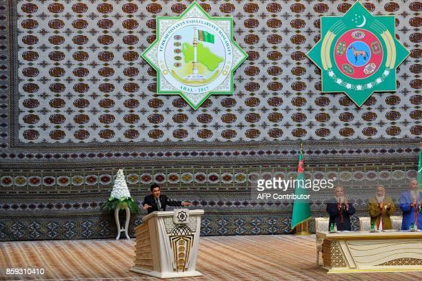 Turkmen President Gurbanguly Berdymukhamedov addresses participants at a meeting of the Council of the Elders outside Ashgabat on October 9 2017...