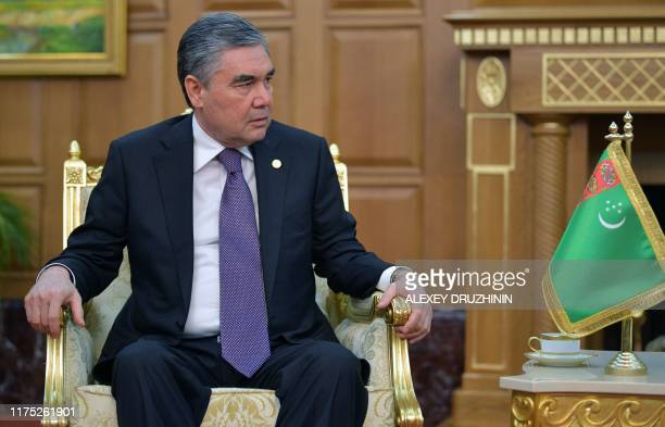 Turkmen President Gurbanguly Berdymukhamedov attends a meeting with his Russian counterpart in Ashgabat on October 11, 2019.