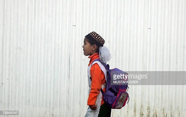 Turkmen school boy walks in Ashgabat 14 February 2007 Turkmenistan's new president Gurbanguly Berdymukhammedov moved 16 February 2007 to fulfil...