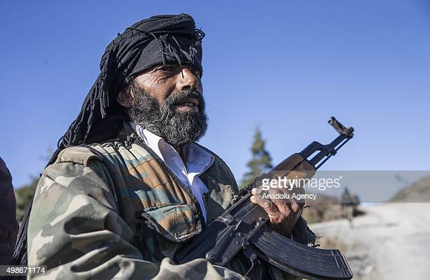Turkmen soldier who escaped to the Yamadi camp stands guard with his rifle, as Russia and Assad regime forces continue its air attacks on Turkmen...
