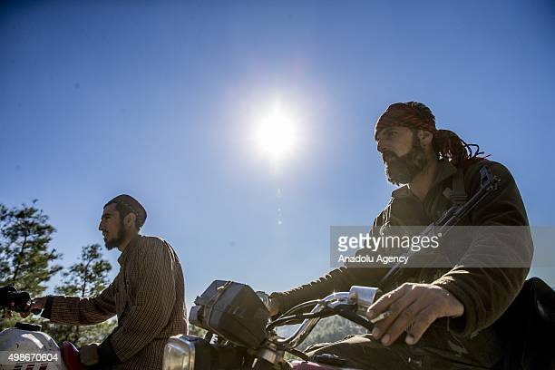 Turkmen soldiers patrol with motorcycles, as Russia and Assad regime forces continue its air attacks on Turkmen town of Bayirbucak in Lattakia, Syria...