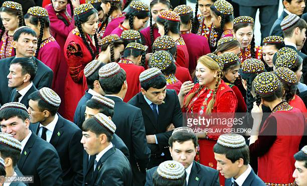 Turkmen students wearing traditional embroidered caps speak on November 17 2010 during the opening of the annual oil and gas conference bringing...