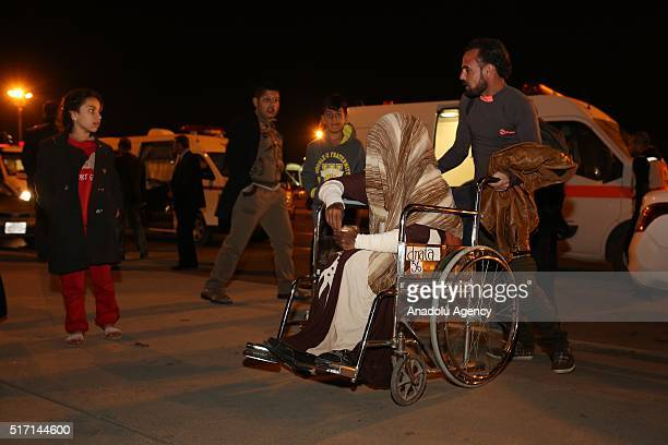 Turkmen who have been affected by the mustard gas attack of ISIS in Tuz Khormatu District of Kirkuk are brought to Erbil International Airport before...