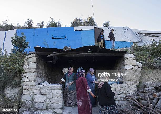 Turkmen women prepare foods for their families who escaped to the Yamadi camp, as Russia and Assad regime forces continue their air attacks on...