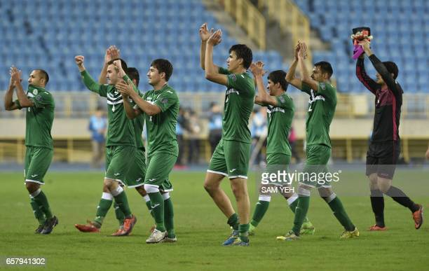 Turkmenistan football players celebrate their 31 victory over Taiwan in the qualifying football match between Taiwan and Turkmenistan for the 2019...