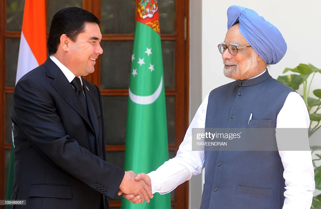 Turkmenistan President Gurbanguly Berdimuhamedov (L) shakes hands with Indian Prime Minister Manmohan Singh during a meeting in New Delhi on May 25, 2010. Turkmenistan's President Gurbanguly Berdimuhamedov is on a three-day state visit to India till May 26.