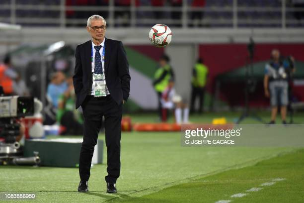 Turkmenistan's coach Hector Cuper eyes the ball during the 2019 AFC Asian Cup group F football match between Japan and Uzbekistan at the Khalifa bin...
