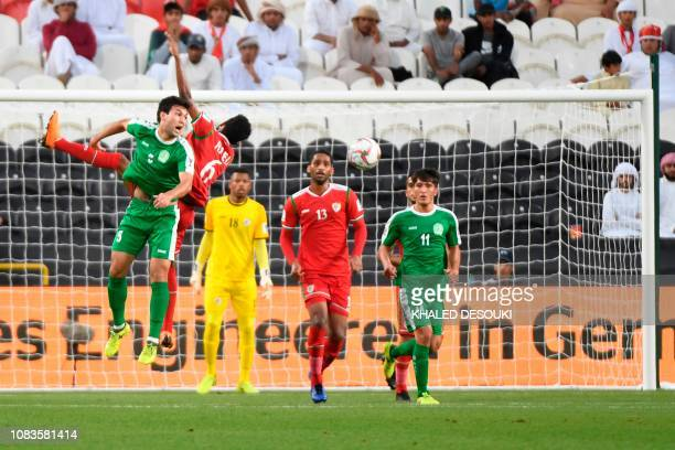 Turkmenistan's defender Wezirgeldi Ylyasow vies for the header with Oman's midfielder Raed Saleh during the 2019 AFC Asian Cup group F football match...