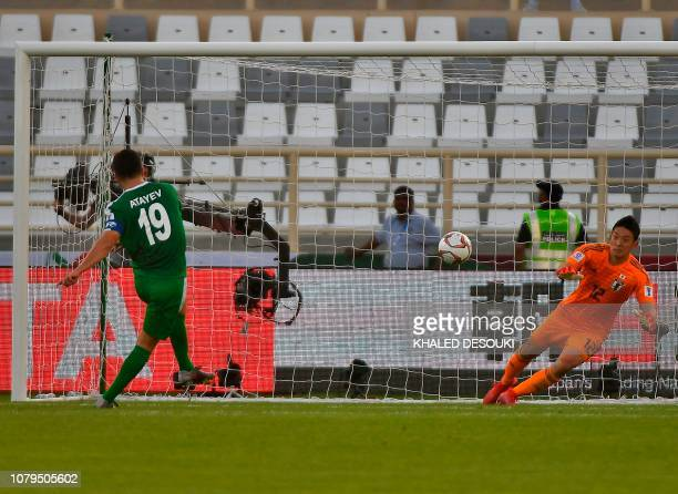 Turkmenistan's midfielder Ahmet Atayev scores during a penalty shot during their Group F, UAE 2019 Asian Cup football match between Japan and...