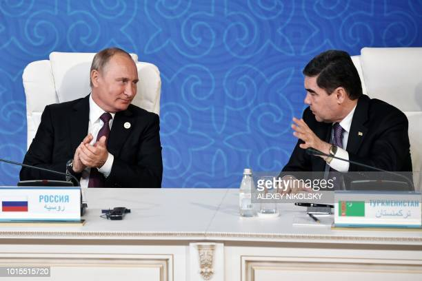 Turkmenistan's President Gurbanguly Berdymukhamedov and Russian President Vladimir Putin speak during the signing ceremony at the fifth Caspian...