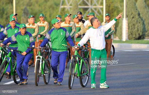 Turkmenistan's President Gurbanguly Berdymukhamedov gestures as he attends World Bicycle Day in Ashgabat on June 3, 2020. - Thousands of...