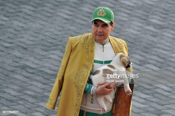Turkmenistan's President Gurbanguly Berdymukhamedov holds a Turkmen shepherd dog, locally known as Alabai, as he takes part in celebrations for the...
