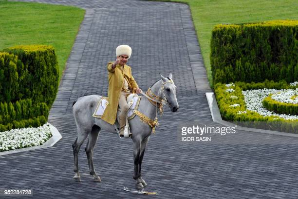 Turkmenistan's President Gurbanguly Berdymukhamedov riding an AkhalTeke stallion takes part in celebrations for the Day of the Horse in Ashgabat on...