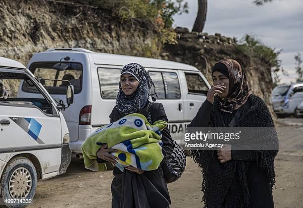 Turkmens who had to fled their homes because of the air attacks of Assad regime and Russia walk as they go to Turkey border in Lattakia Syria on...