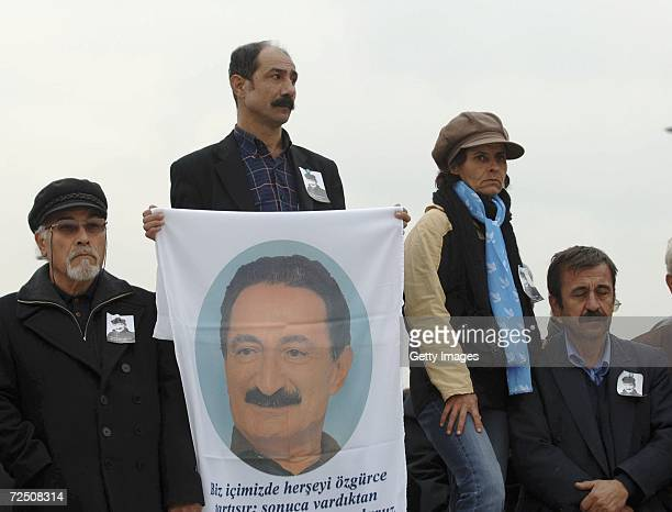 Turks attend the funeral ceremony of former Prime Minister Bulent Ecevit in front of Turkish parliament on November 11 2006 in Ankara Turkey The...