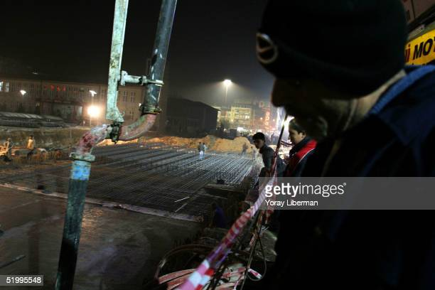 Turks look at a construction site on the main street where passageways have been built to ease the traffic in the city center December 4 2004 in...