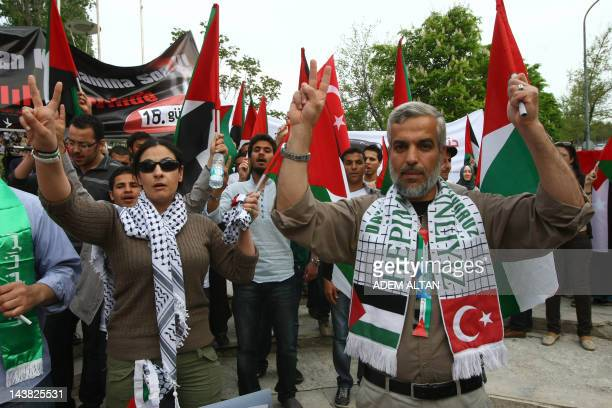 Turks wave Palestinian and Turkish flags during a support rally for Palestinian inmates on a hunger strike in Israeli jails outside the Israeli...