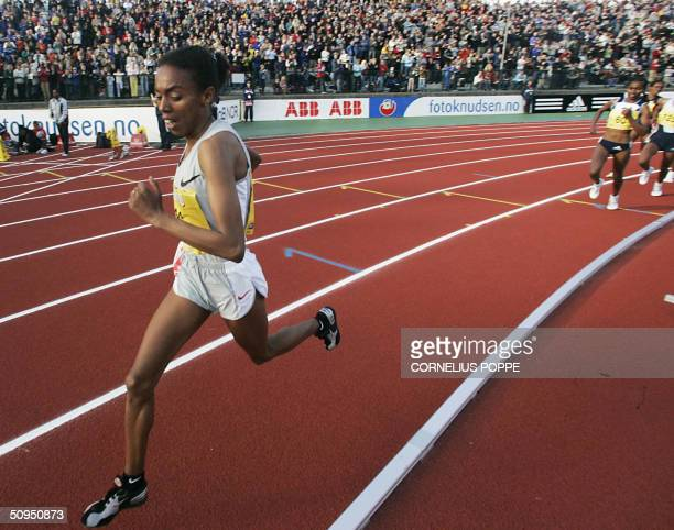Turksih Elvan Abeylegesse runs ahead of the rest of the field as she sets a new world record for the 5000m event for women with a time of 142469 at...