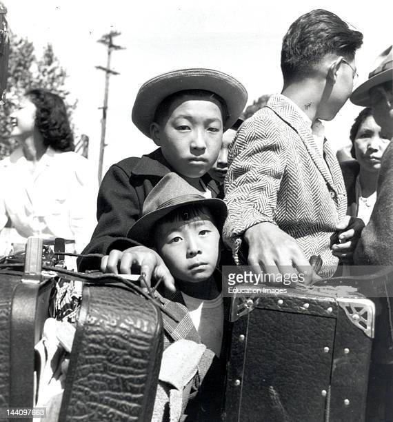 Turlock, California, These Young Evacuees Of Japanese Ancestry Are Awaiting Their Turn For Baggage Inspection At This Assembly Center, Photographer:...