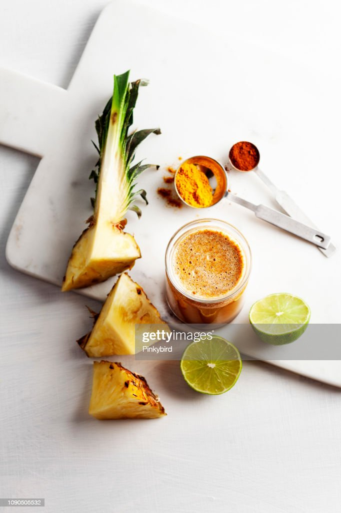 Turmeric and pineapple Smoothies,Detox morning juice drink : Stock Photo