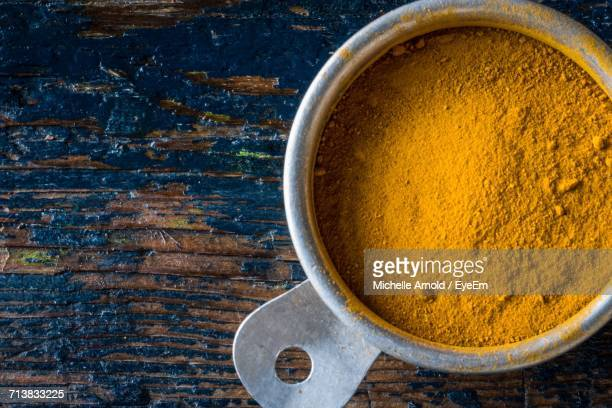 Turmeric In Measuring Cup On Table