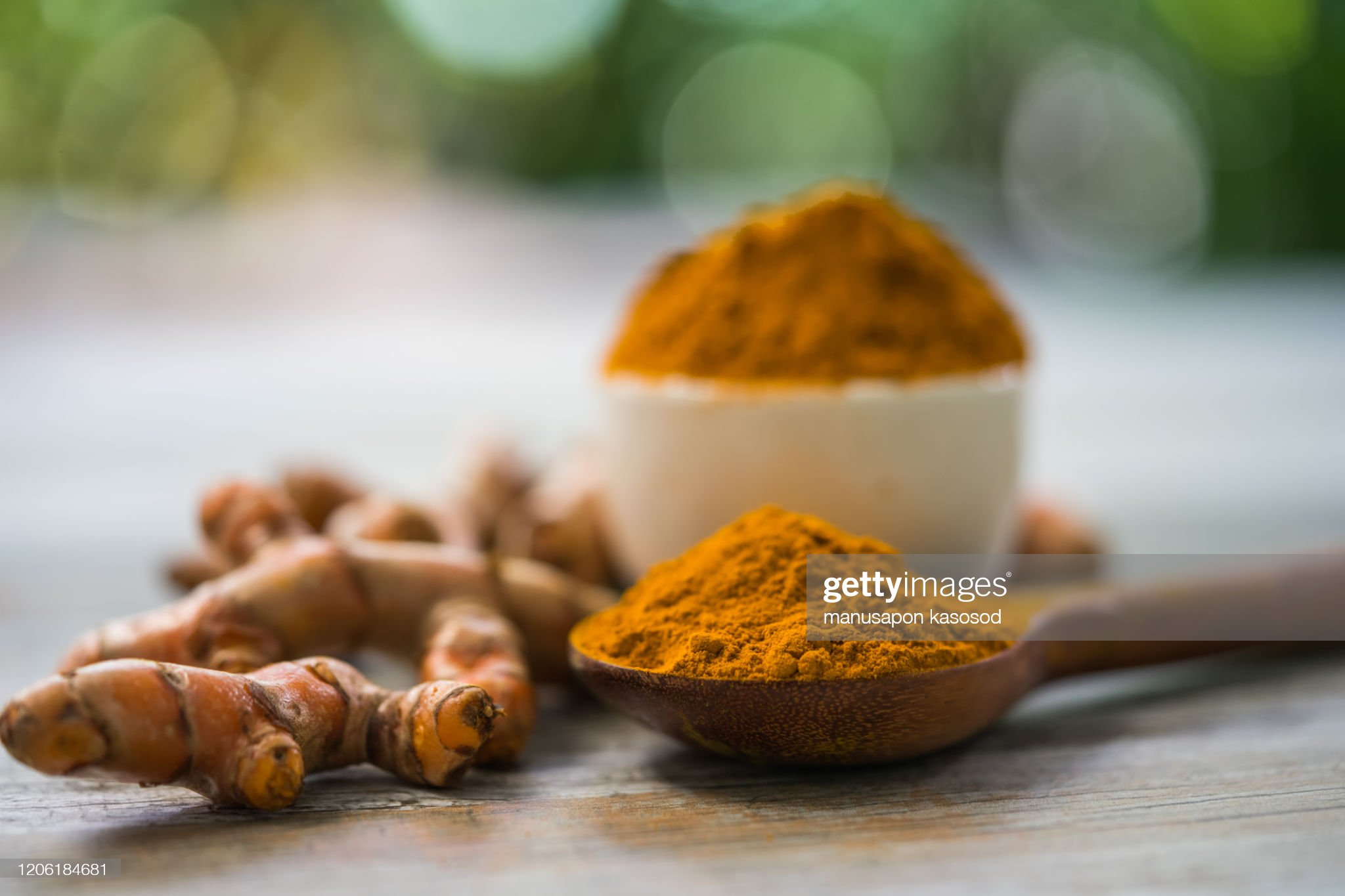 Turmeric powder and fresh turmeric in wood bowls on wooden table. : Stock Photo