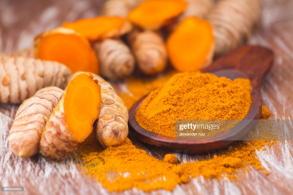 turmeric powder and roots : Stock Photo