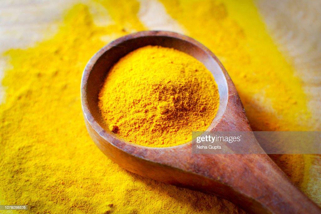 Turmeric Powder - Wooden Spoon : Stock Photo