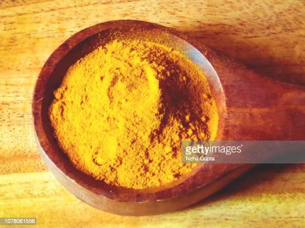 Turmeric Powder - Wooden Spoon