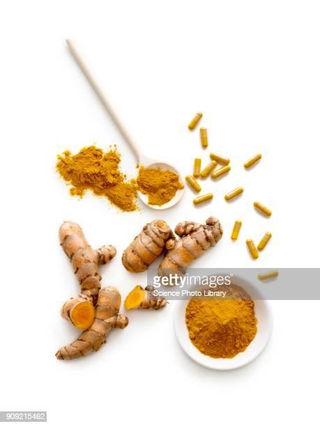 turmeric root, powder and capsules - curcuma fotografías e imágenes de stock