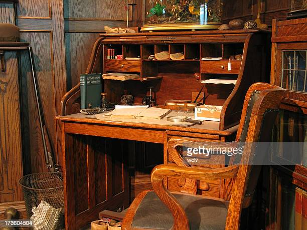 A turn of the century old office table and chair