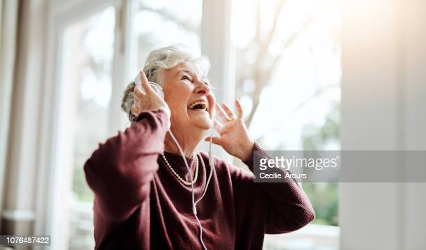 turn up the volume of life - senior adult stock pictures, royalty-free photos & images