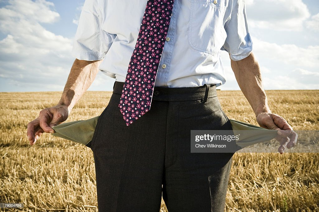 Turned-out pockets in wheat field. : Stock Photo