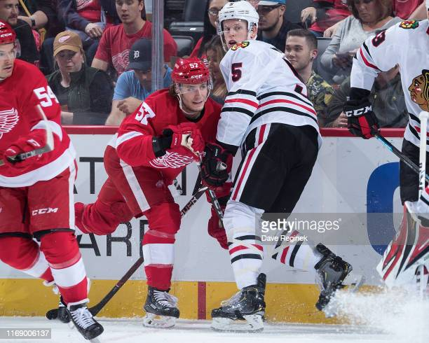 Turner Elson of the Detroit Red Wings battles along the boards with Connor Murphy of the Chicago Blackhawks during a pre-season NHL game at Little...