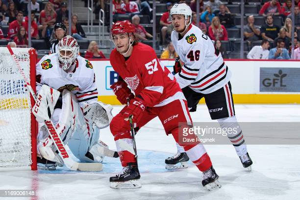 Turner Elson of the Detroit Red Wings battles for position with Lucas Carlsson of the Chicago Blackhawks during a pre-season NHL game at Little...