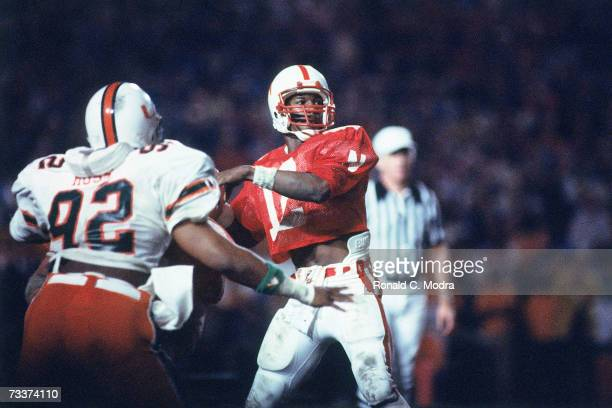 Turner Gill of the Nebraska Cornhuskers passing during the 1984 Orange Bowl Game against the Miami Hurricanes in the Orange Bowl on January 2 1984 in...