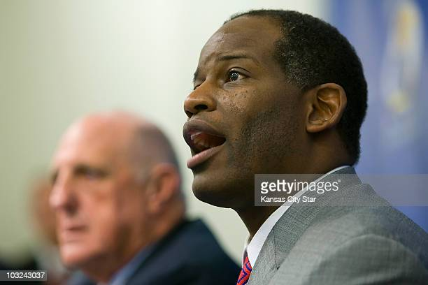 Turner Gill, the new head football coach for the Kansas Jayhawks, answered questions during a press conference in Lawrence, Kansas, on Monday,...