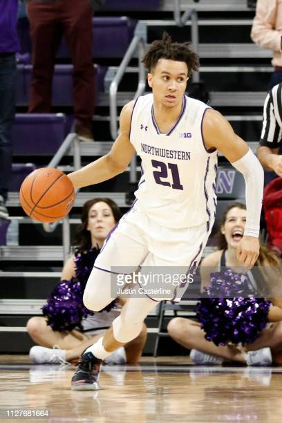 J Turner of the Northwestern Wildcats brings the ball up the court in the game against the Penn State Nittany Lions during the second half at...