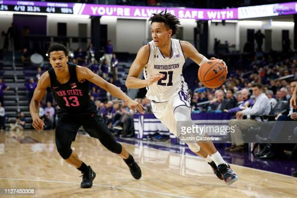 J Turner of the Northwestern Wildcats drives to the basket while being guarded by Rasir Bolton of the Penn State Nittany Lions during the second half...
