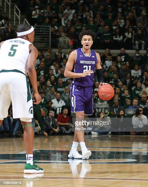 J Turner of the Northwestern Wildcats handles the ball during the game against the Michigan State Spartans in the second half at Breslin Center on...