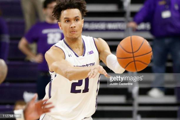 J Turner of the Northwestern Wildcats passes the ball in the game against the Penn State Nittany Lions during the second half at WelshRyan Arena on...