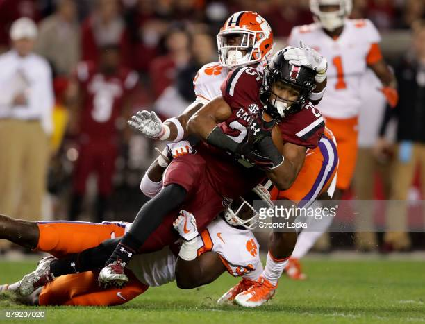 J Turner of the South Carolina Gamecocks is tackled by the defense of the Clemson Tigers during their game at WilliamsBrice Stadium on November 25...
