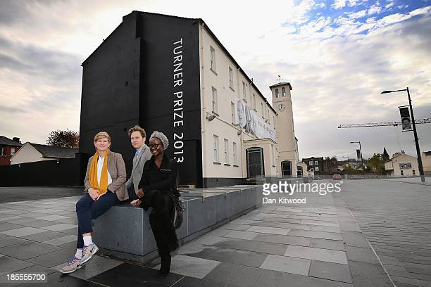 Turner Prize nominated artists David Shrigley Lynette YiadomBoake and Laure Prouvost pose for a photograph in Ebrington Square on October 22 2013 in...