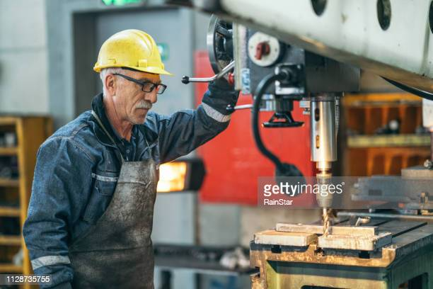turner worker working on drill bit in a workshop - occupation stock pictures, royalty-free photos & images