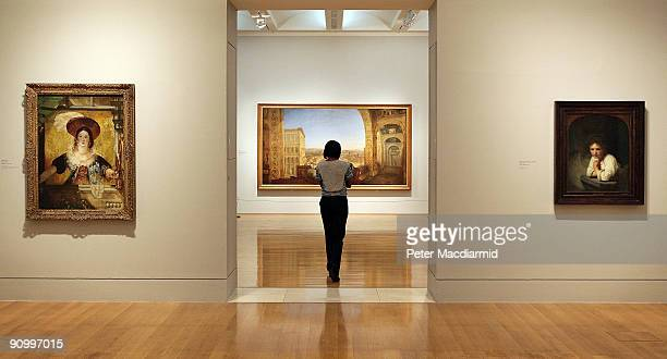 Turner's 'Rome from the Vatican' and 'Jessica' hang near Rembrandt's 'Girl at a Window' at the 'Turner and the Masters' exhibition at Tate Britain...